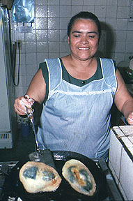 Dolores Duran cooks up some chilles rellenos in the food market of Tequisquipan